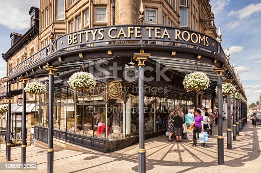 5 May 2016: Harrogate, North Yorkshire, UK - Bettys Cafe Tea Rooms, and a queue waiting outside to go in.