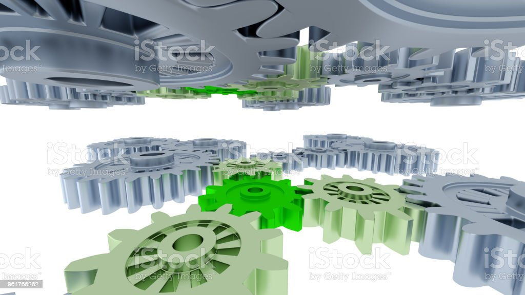 Between Silver Gears and Small Green and Light Green Gears royalty-free stock photo