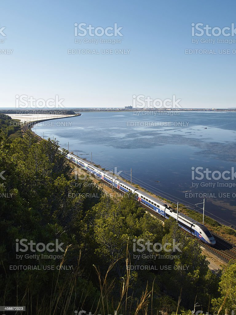 TGV between water and trees stock photo