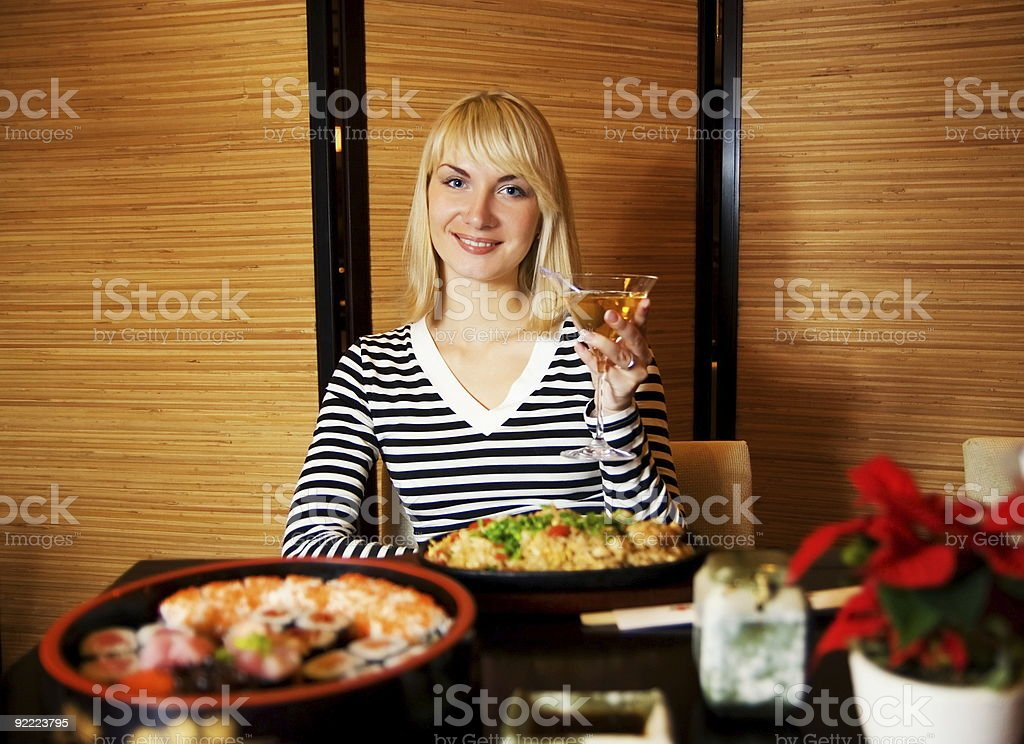 Beutiful blond girl in japanese restaurant royalty-free stock photo