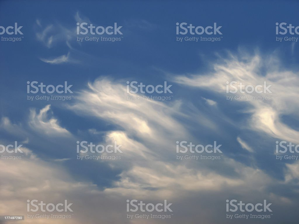 Beutiful delicate fragile clouds in blue sky royalty-free stock photo