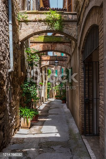 istock Bevagna, Umbria, Italy: narrow alley in the old town 1214766032