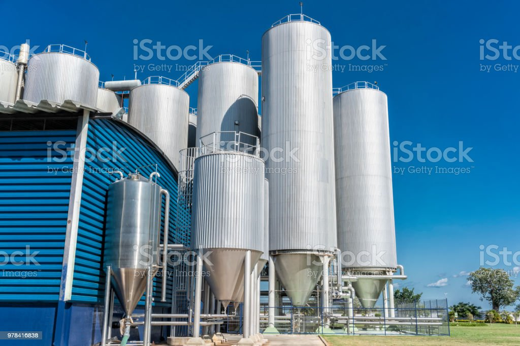 Beverage factory cylinders. With blue sky. stock photo
