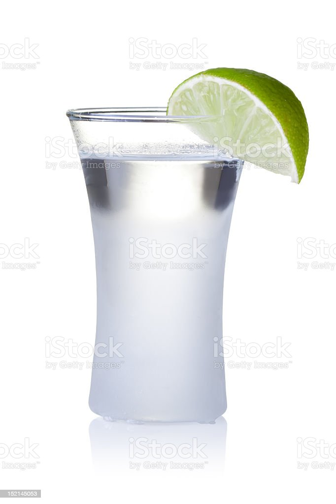 Beverage in a tall glass with a wedge of lime royalty-free stock photo