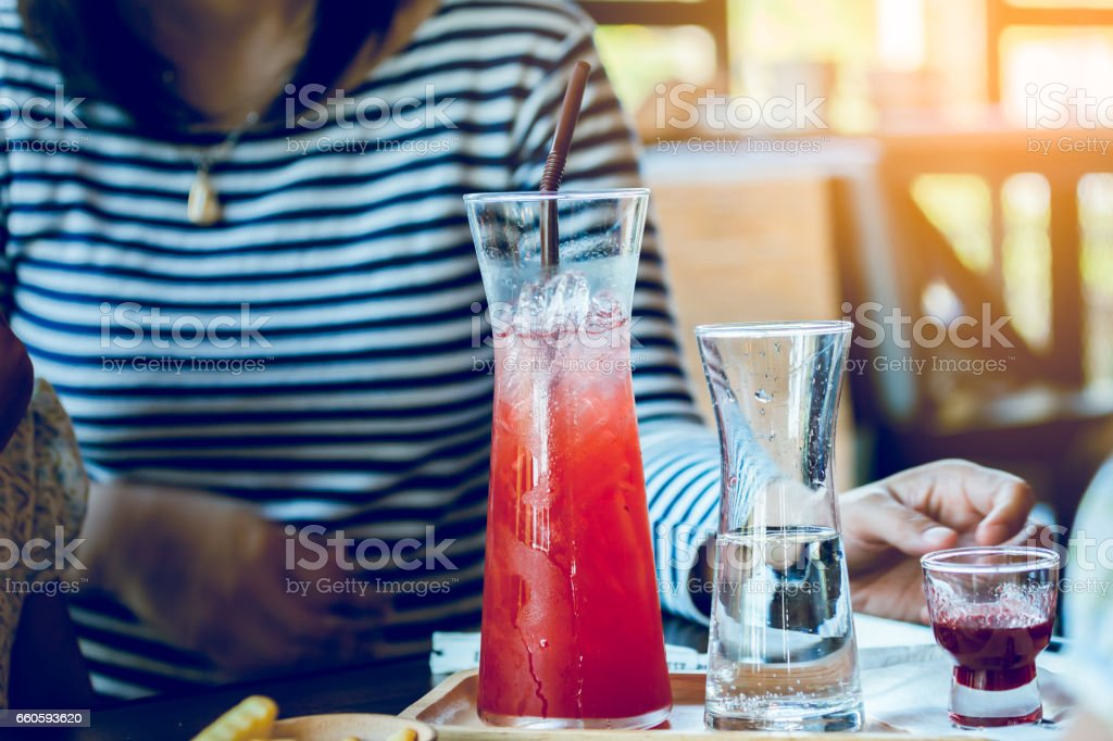 Beverage in beautiful flask with young woman in cafe royalty-free stock photo