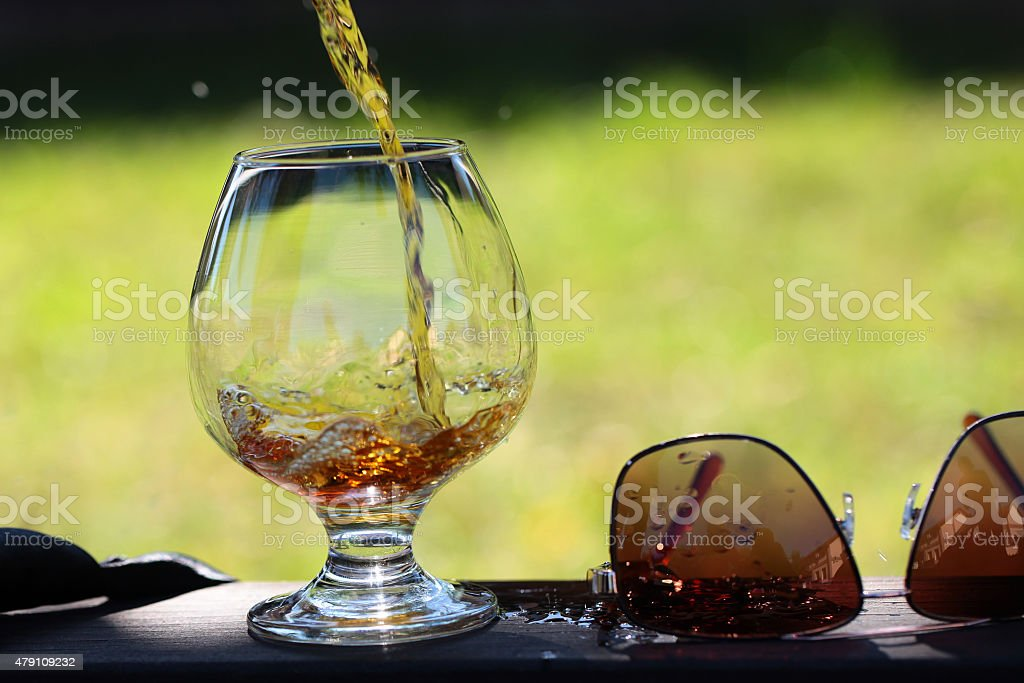 Beverage poured in bocal stock photo