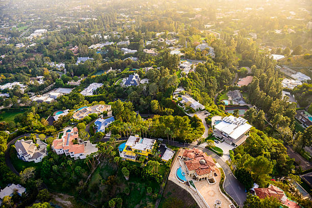 Beverly Hills mansions landscape aerial view -Los Angeles California Los Angeles California - Beverly Hills landscape and mansions aerial view late afternoon hollywood california stock pictures, royalty-free photos & images