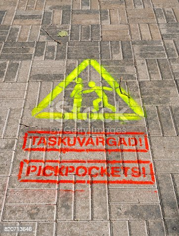 istock Beware of Pickpockets - pavement warning sign in Tallinn, Estonia 820713646