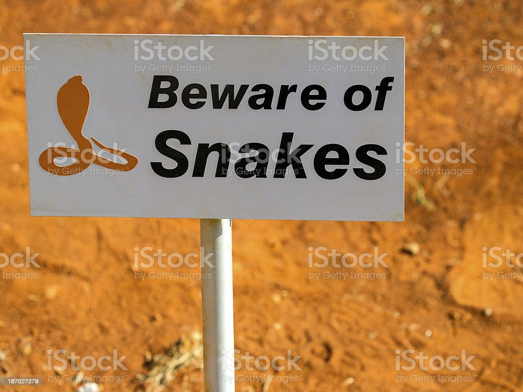 Beware of snakes sign with orange background stock photo