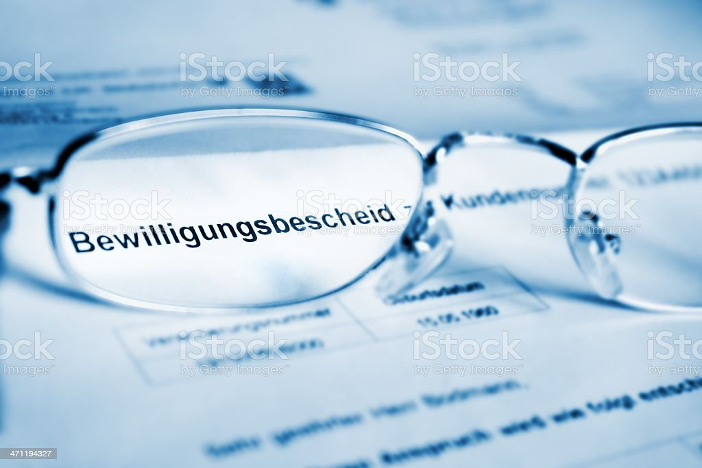 Bewilligungsbescheid- glasses on german document stock photo