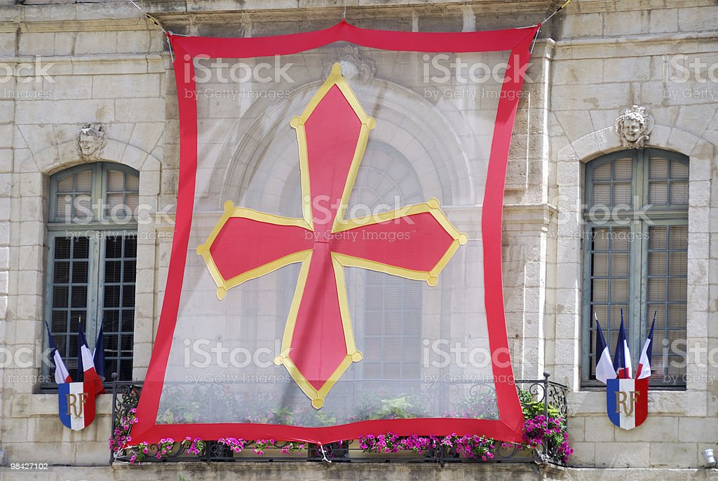 Beziers (Languedoc-Roussillon, France) - Exterior of historic building and flags royalty-free stock photo