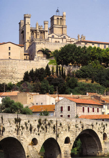 Beziers Old Bridge and Cathedral Occitanie Herault Languedoc Roussillon France stock photo