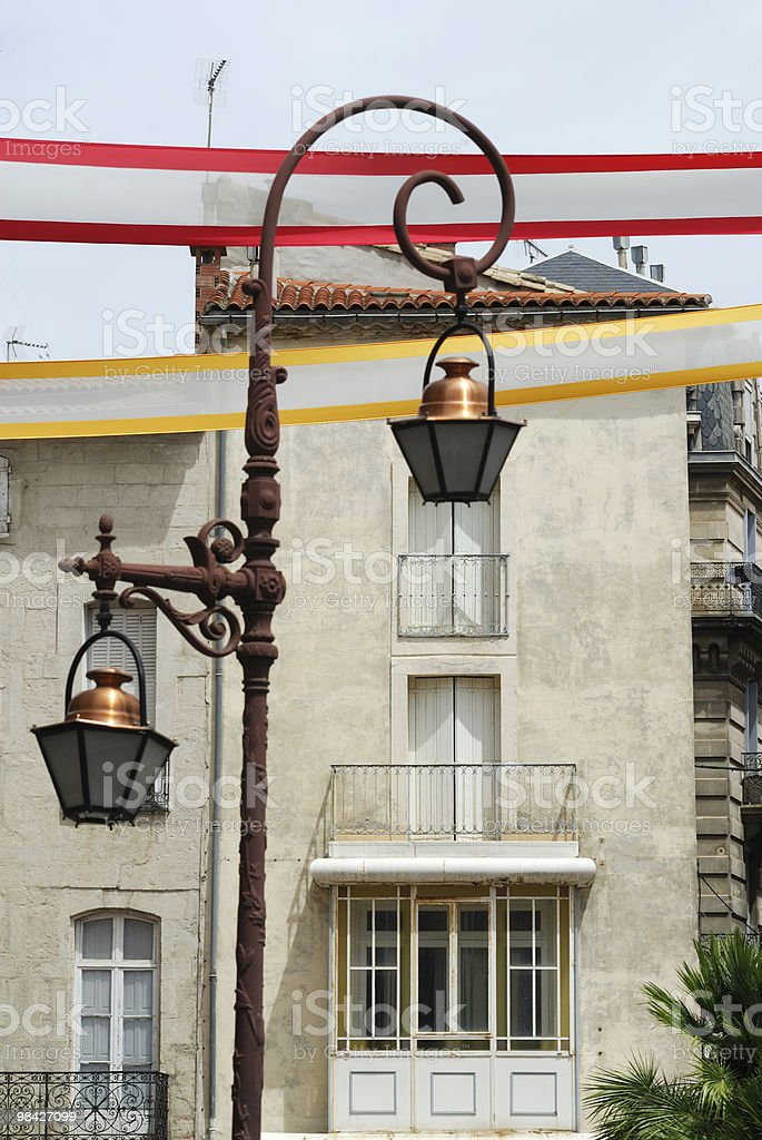 Beziers (Languedoc-Roussillon, France) - Street lights and colorful banners royalty-free stock photo