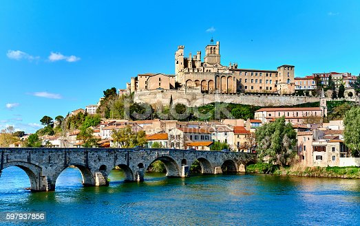 The old Arch Bridge and cathedral Saint-Nazaire in the Beziers town. Cathedral is the largest Gothic monument in the city. Built in the XIV century, It's a symbol of the city. Languedoc-Roussillon, France