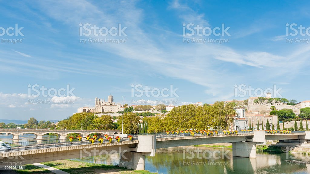 Beziers view acrosstwo bridges over Orb River to city stock photo