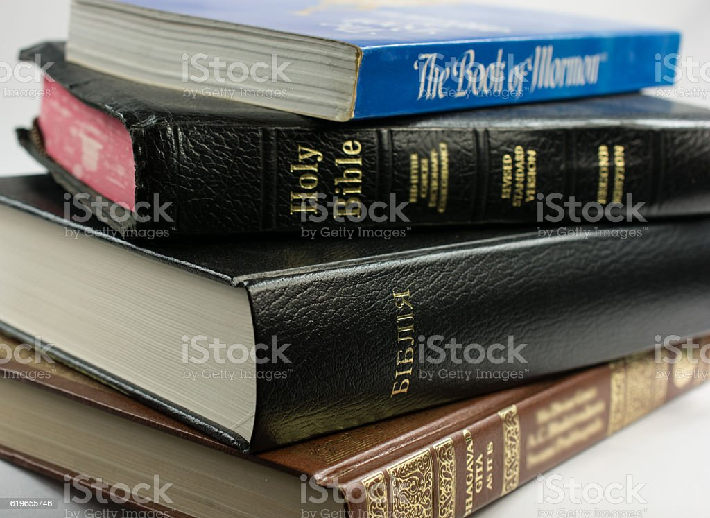 Bhagavad Gita, Book of Mormon, Christian and Ukranian doctrine books stock photo