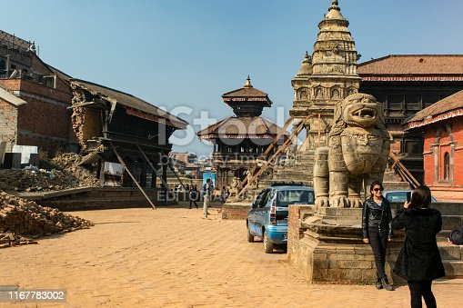 Khatmandu, Nepal - January 03, 2016. Bhaktapur durbar square still visited by tourist although most building was demolished by earthquake