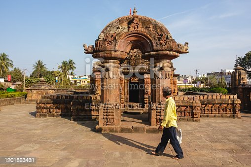 Bhubaneshwar, Orissa, India - February 2018: The beautifully decorated and ornate arch that marks the entrance to the ancient 11th century Muktesvara temple.