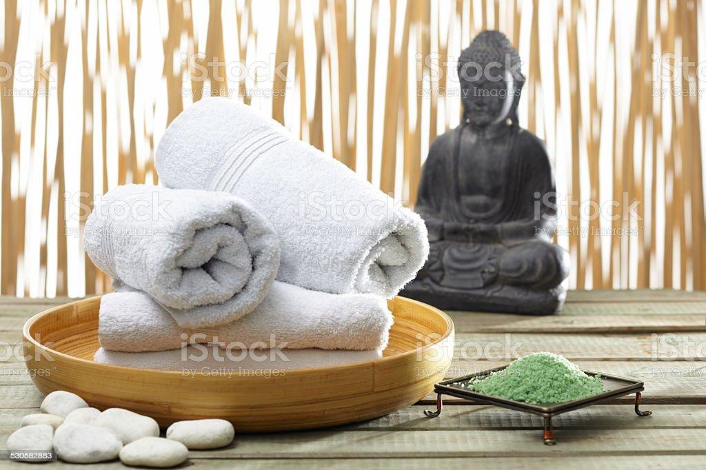 Bhuddha, towels, bath salts stock photo