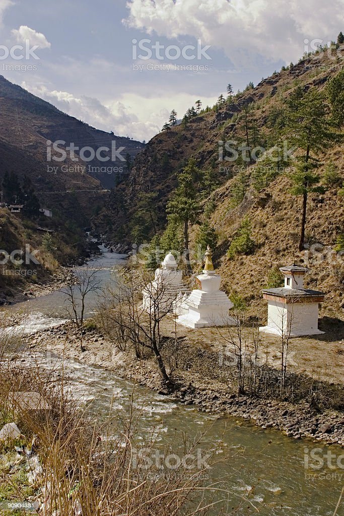 Bhutan: Buddhist Stupas by a River royalty-free stock photo