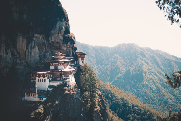bhutan buildings early in the morning with mist bhutan buildings early in the morning with mist monastery stock pictures, royalty-free photos & images