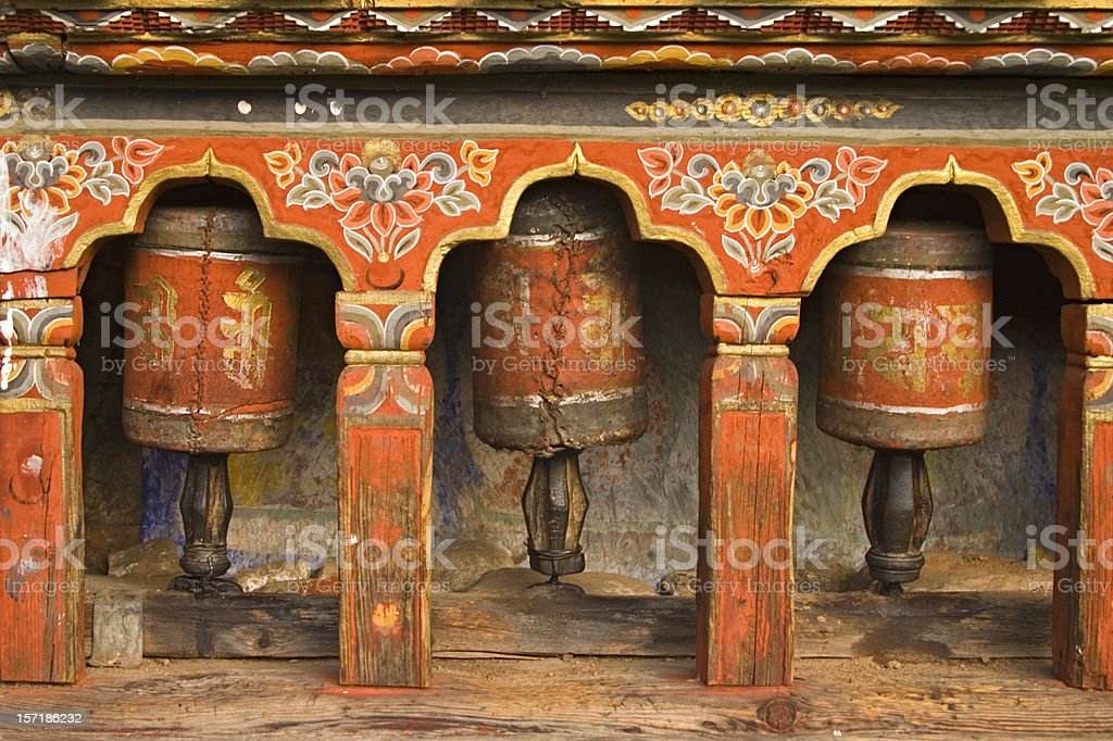 Bhutan - Old Prayer Wheels at Monastery stock photo