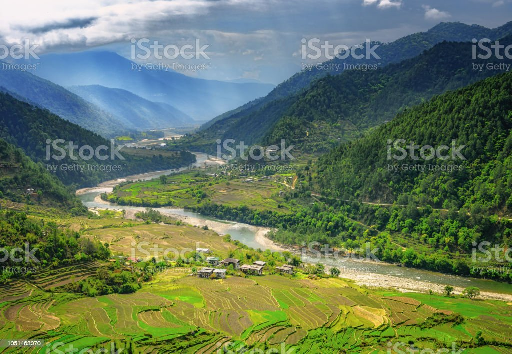 Bhutan valley and rice farms stock photo