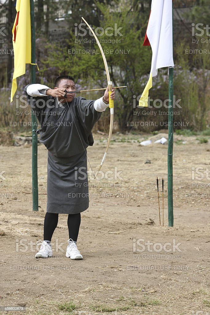 Bhutanese men competing in the national sport of archery