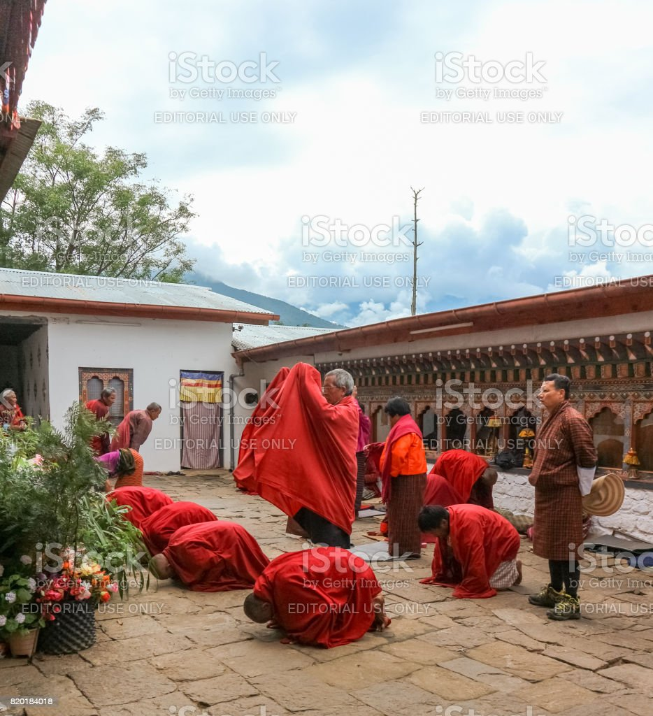 Bhutanese monks in tradtional dress praying in Thimphu, Bhutan stock photo