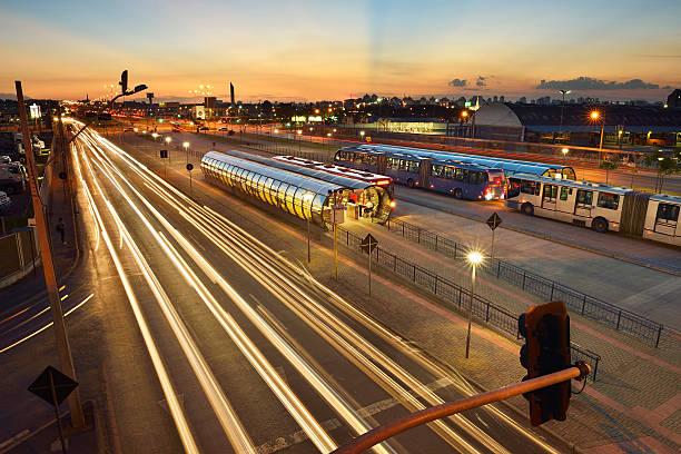 bi-articulated bus terminal - curitiba stock photos and pictures