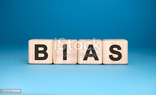Bias - text on wooden blocks, personal opinions prejudice, blue background