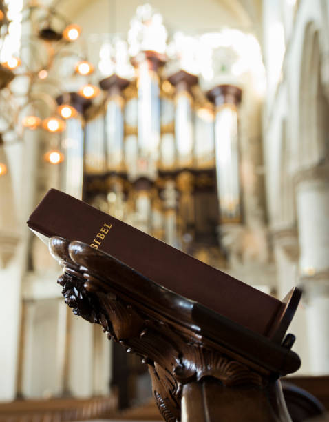 bibel in a church in holland Bible on the pulpit in achurch in holland with an organ in the background pulpit stock pictures, royalty-free photos & images