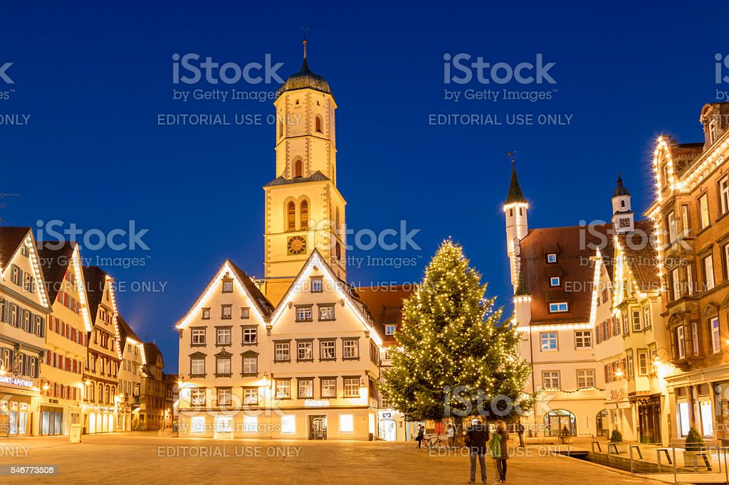 Town square in the old town of Biberach illuminatedat dusk, decorated...