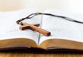 istock Bible and cross on desk 842379598