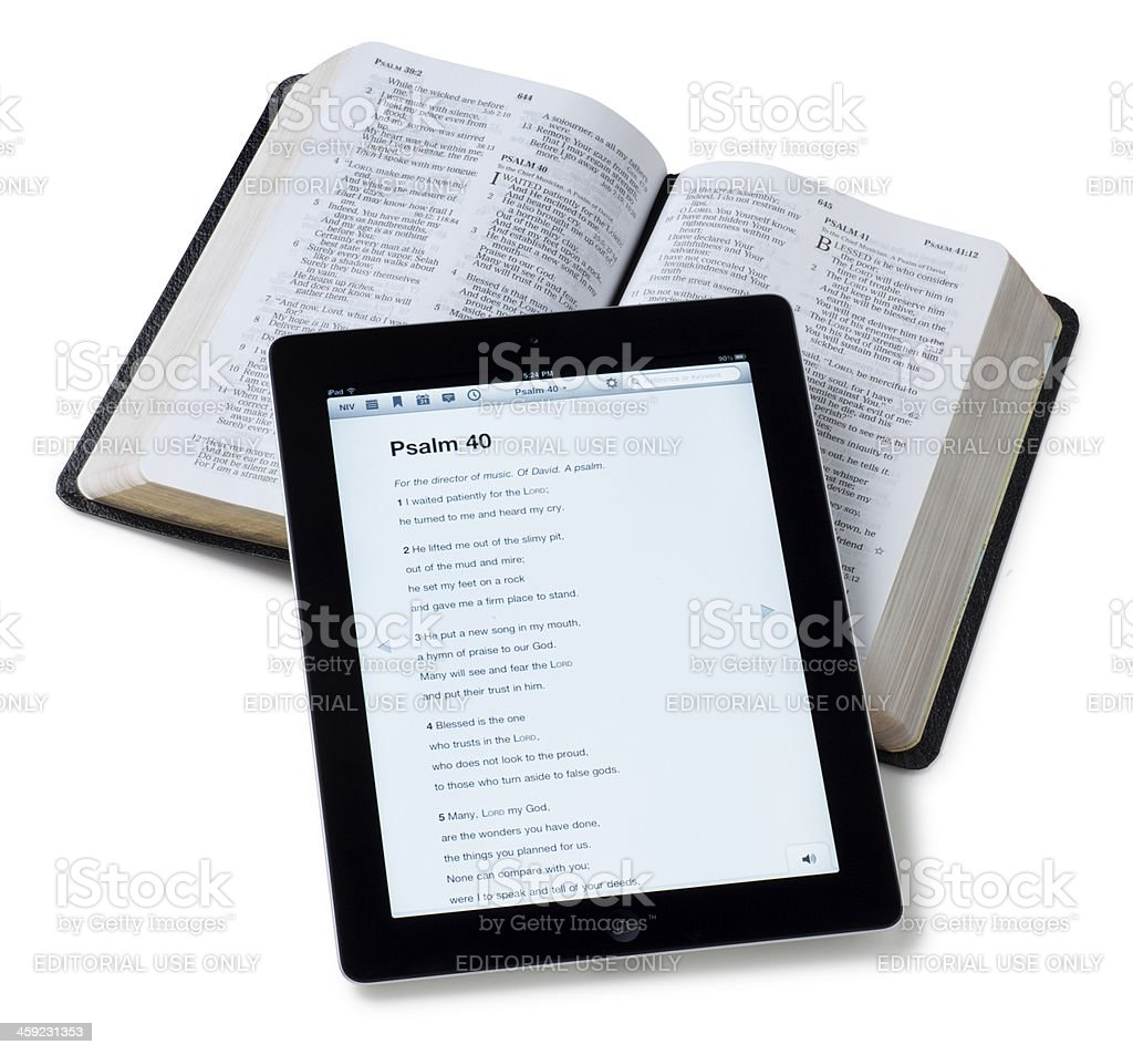 Bible and iPad App on White stock photo
