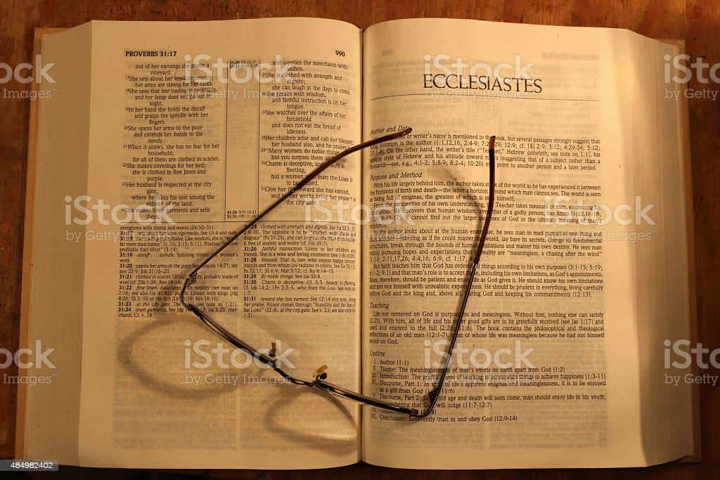 bible and reading glasses stock photo