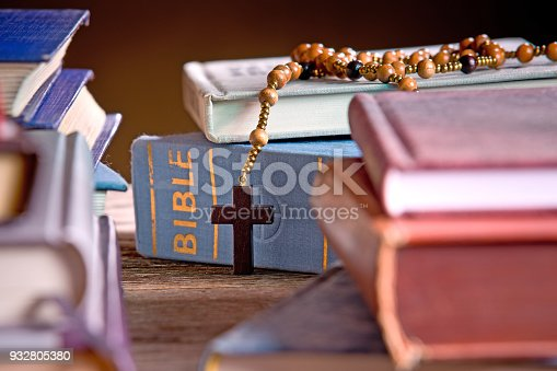 istock Bible  and Wooden Rosary in the Bookshelf 932805380