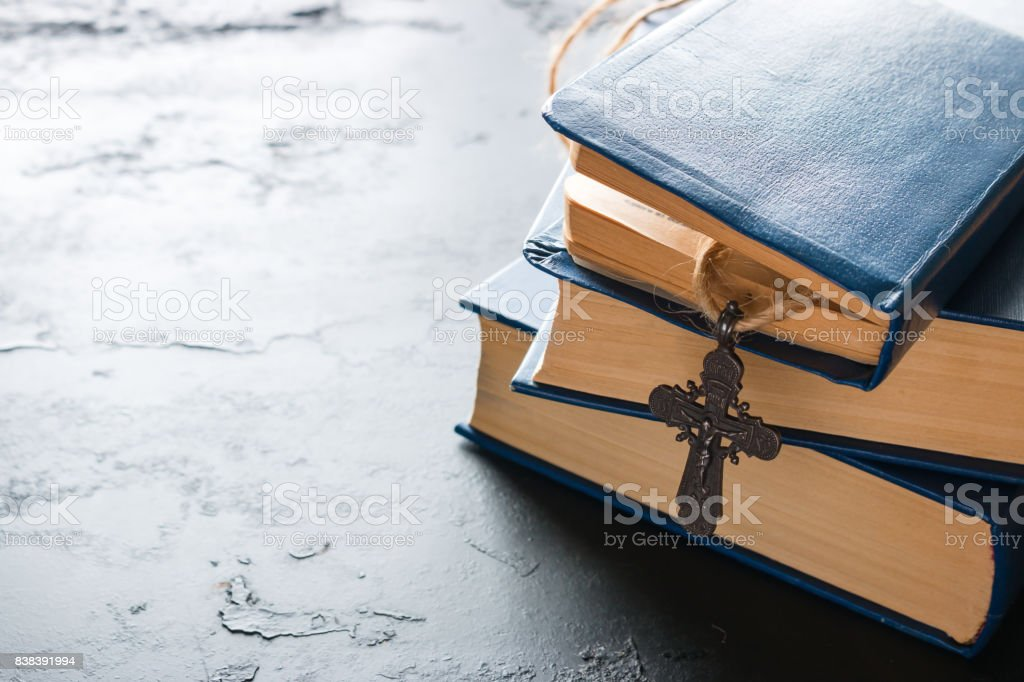 Bible books and christian cross close up stock photo