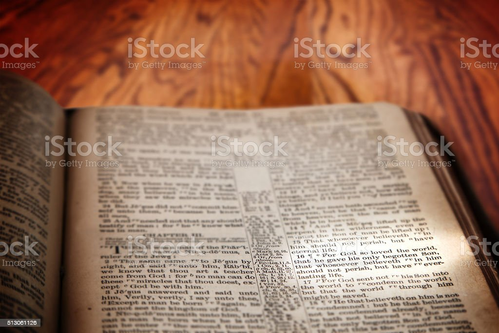 Bible Famous Verse John 3:16 on Rustic Wooden Background stock photo