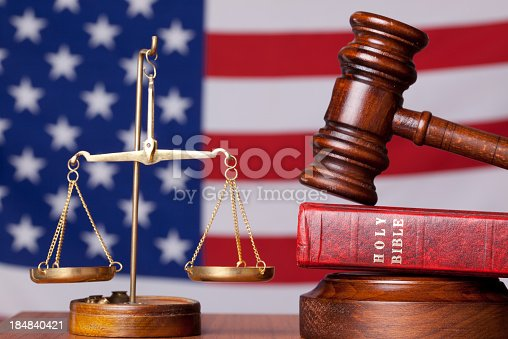 istock Bible, gavel and scales of justice on american flag background 184840421
