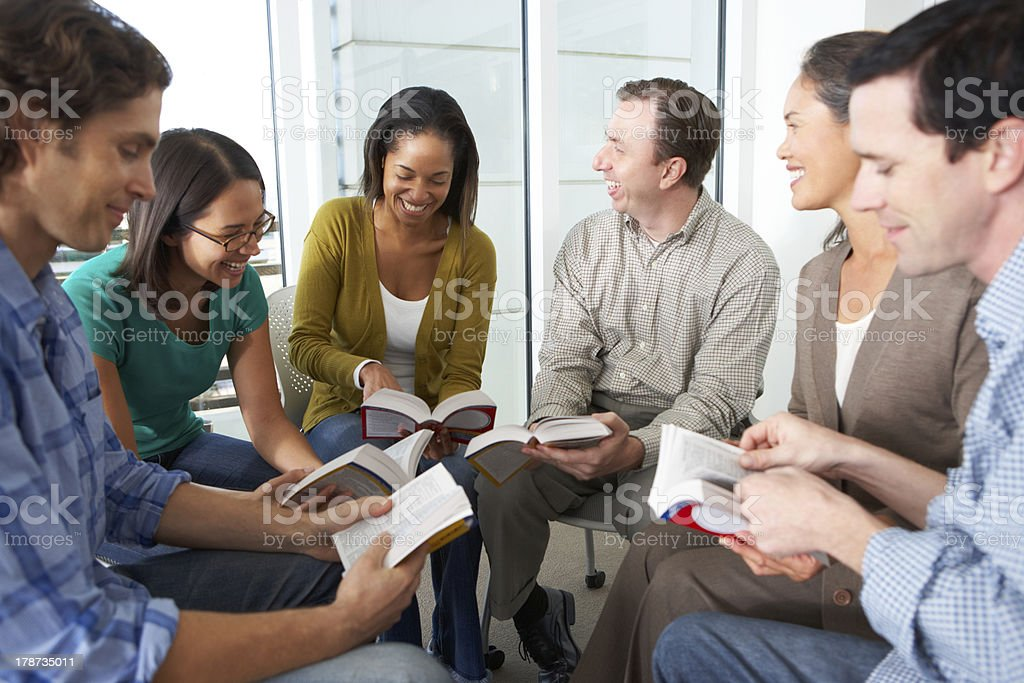 Bible group reading together in a close circle stock photo
