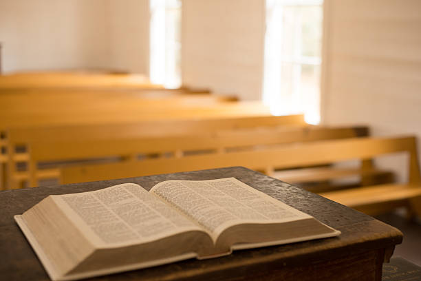 Bible in Primitive Church New Christian Bible, open to Psalm 23, sits on the pulpit of the historic Palmer Chapel in Cataloochee, North Carolina, preserved in the Great Smoky Mountains National Park. pulpit stock pictures, royalty-free photos & images