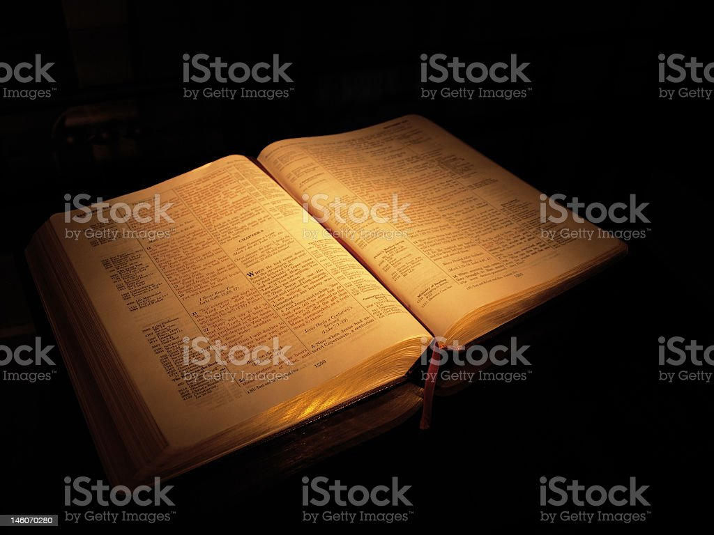 Bible in the shadows stock photo