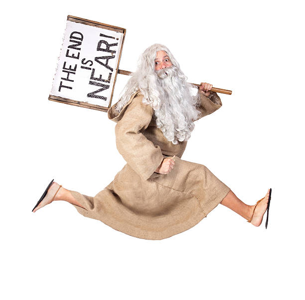 A bible inspired dressed man holding a the end is near  visionary runs with a sign on his shoulder approaching stock pictures, royalty-free photos & images
