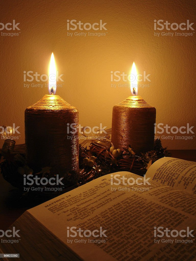 Bible lit by candles royalty-free stock photo