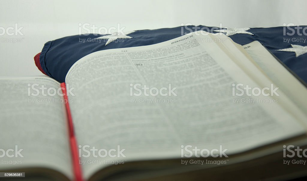 bible on the american flag stock photo