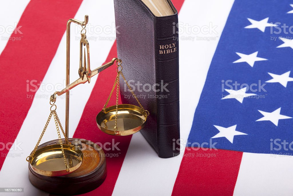 Bible, scales of justice and American Flag on white background stock photo