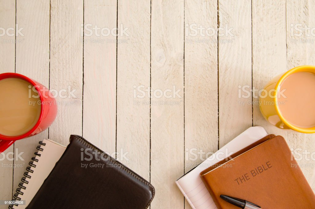 Bible Study and a Cup of Coffee with a Friend on a Wooden Table stock photo