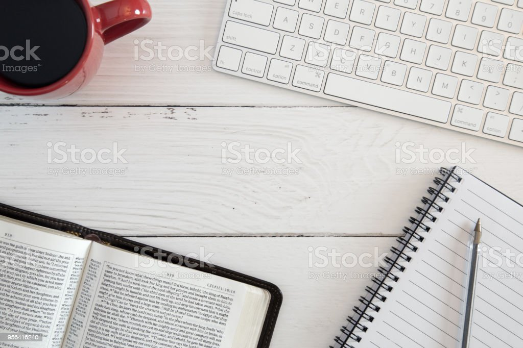 Bible Study on a White Wood Computer Table stock photo
