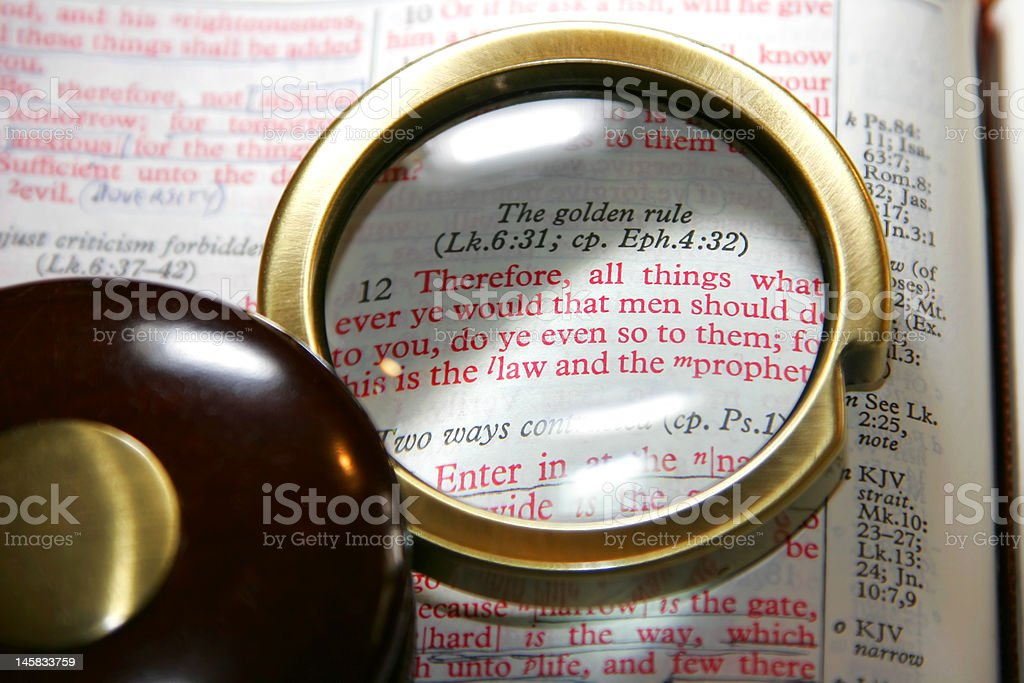 Bible Under Magnifying Glass stock photo